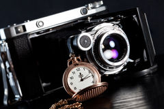Retro camera and pocket watch Royalty Free Stock Photo