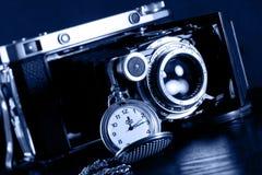 Retro camera and pocket watch Royalty Free Stock Image