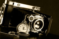 Retro camera and pocket watch Royalty Free Stock Photos