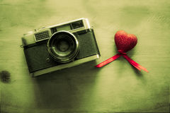 Retro Camera with red hearts  background Stock Photo
