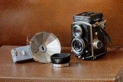 Retro camera Rollieflex, flash and lens shade Stock Photos