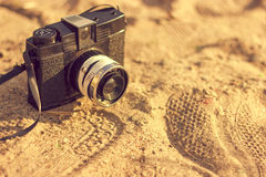 Retro camera on sand Stock Photography