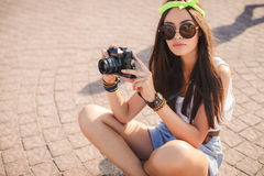 Retro camera shoots girl in the streets of the city. Stock Photography