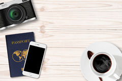 Retro camera,Smartphone and passport on wood Table Stock Photo