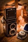 Retro camera. Standing on craftmans workbench stock photos