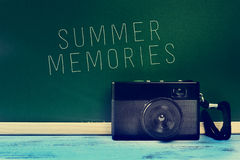 Retro camera and the text summer memories, filtered Stock Photography