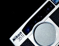 Close up photo of the Nikon 35Ti, retro CAMERA. RETRO CAMERA  the 35Ti Titanium compact camera from Nikon. These cameras with 35mm film technology and Nikon 35Ti royalty free stock photography