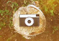 Retro camera top view. On the wood Royalty Free Stock Photo