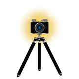 Retro camera on tripod Royalty Free Stock Photography