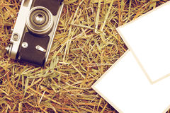 Retro camera with two blank isolated photos Royalty Free Stock Photography