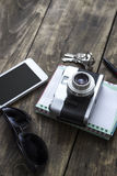 Retro camera and various personal items Royalty Free Stock Image