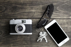 Retro camera and various personal items Stock Photography