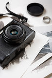 Retro camera and watercolor paintings on white table background Stock Image