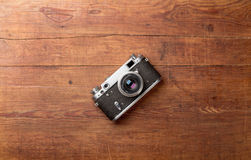 Retro camera on wood table background Royalty Free Stock Image