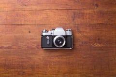 Retro camera on wood table background Royalty Free Stock Photo