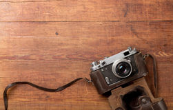 Retro camera on wood table background Royalty Free Stock Photography