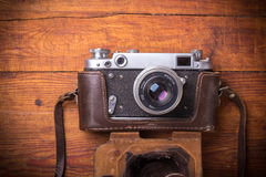 Retro camera on wood table background Royalty Free Stock Photo
