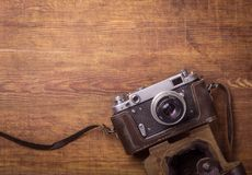 Retro camera on wood table Royalty Free Stock Images