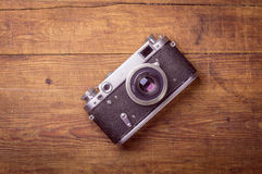 Retro camera on wood table Royalty Free Stock Photo