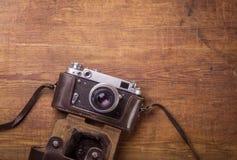 Retro camera on wood table Stock Photo