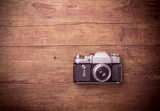 Retro camera on wood table Stock Photos