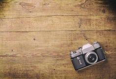 Retro camera on wood table Royalty Free Stock Photography
