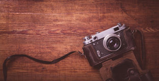 Retro camera on wood table background vintage color tone Stock Images
