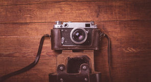 Retro camera on wood table background vintage color tone Stock Photo