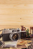 Retro camera on wood table background, vintage color tone Royalty Free Stock Photo