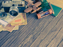 Retro camera on wood table background, vintage color tone Royalty Free Stock Photos