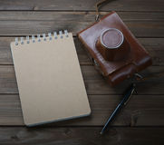 Retro camera on wooden table Stock Photography