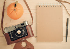 Retro camera on wooden table Stock Image