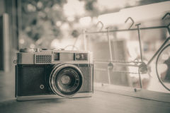 Retro camera on wooden table Stock Photo