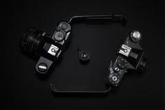 Retro  cameras. Analog retro photo cameras on a dark background Stock Photo