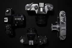 Retro cameras. Analog retro photo cameras on a dark background Royalty Free Stock Photography