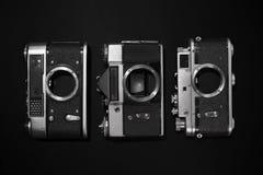 Retro cameras. Analog retro photo cameras on a dark background Stock Image