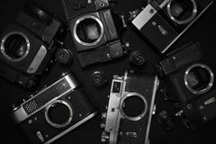 Retro cameras. Analog retro photo cameras on a dark background Stock Images