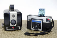 Retro cameras on mat Royalty Free Stock Photo