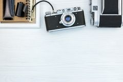 Retro cameras, negative films, photo frame and notebook with old. Pictures, flat view Royalty Free Stock Image