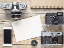Retro cameras. Retro photography camera tools on a wood background royalty free stock image