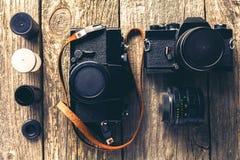 Retro Cameras and photos Stock Images