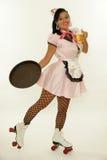 Retro cameriera di bar con il pattino di rullo fotografia stock libera da diritti