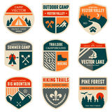 Retro camp badges. Set of vintage outdoor camp badges and emblems Stock Photography