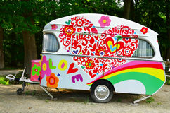 Retro camper. Retro caravan near green trees royalty free stock images