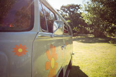 Retro camper van in a field. On a summers day Royalty Free Stock Photo
