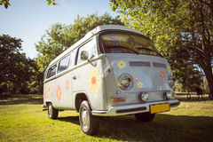 Retro camper van in a field. On a summers day Royalty Free Stock Image