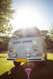 Retro camper van in a field. On a summers day Stock Image