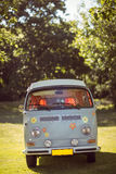 Retro camper van in a field. On a summers day Stock Photo