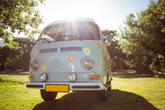 Retro camper van in a field. On a summers day Stock Photos