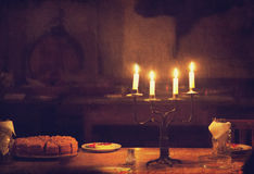 Retro candle and cake on table. Photo in old vintage style. Royalty Free Stock Image